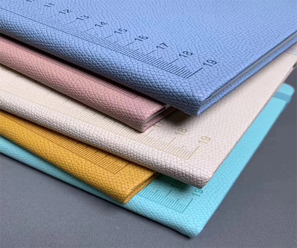 New arrival embossed pu synthetic stocklot leather for notebook cover material